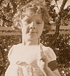 Donna Williams aged 6 running with a stick